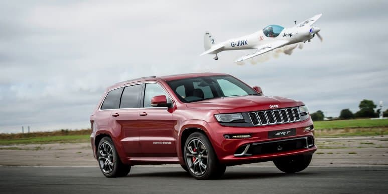 Jeep Grand Cherokee SRT beats aerobatic plane